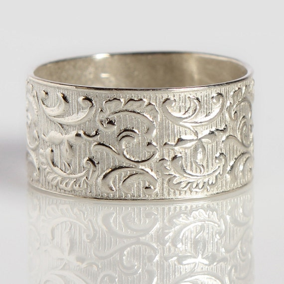 Wide Silver Ring Decorated With Tribal Symbols Yahely