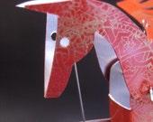 Red Aluminium Pegasus Automata stamped in gold.