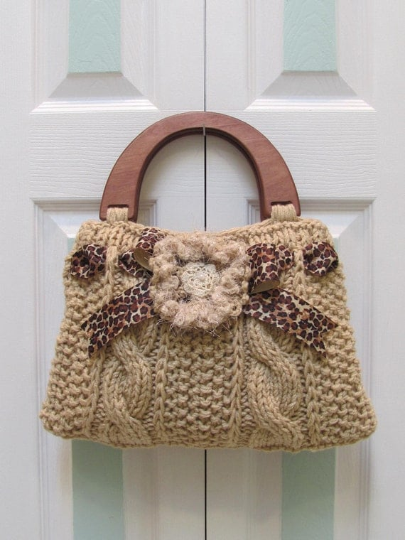 HANDBAG/ PURSE, Beige, hand knitted in a designer style, leopard gro grain ribbon, brown wood handles