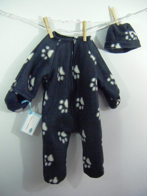 Baby Bunting in white paw print on black fleece