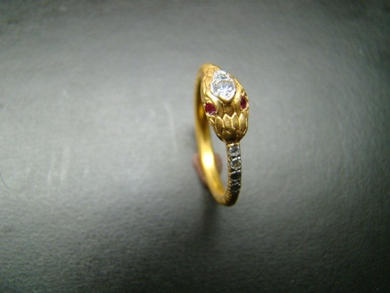 Snake Ring  14k gold  with Diamonds and rubies.