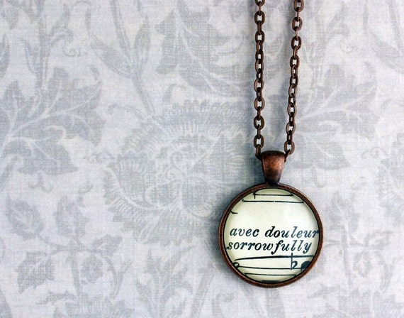 Copper pendant with real vintage sheet music under glass dome.  Sorrowfully