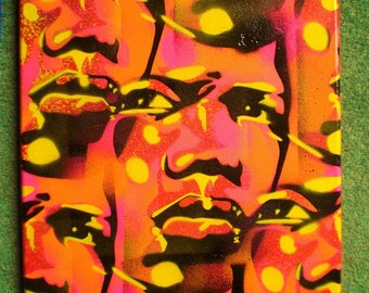 Mans face painting,stencil art,spray paint,pop art,street art,abstract,urban,tribal,wall art,Europe,yellow,pink,orange,graffiti,African,eyes