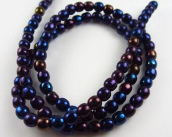 Czech Glass 4 mm Blue Iris Rounds