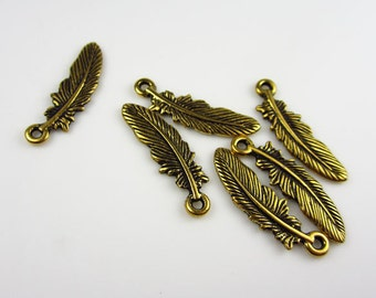 6 Gold Tierracast Small Feather Charms