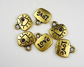 7 Gold Tierracast Love Charms