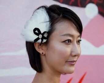 Cream Feather Fascinator with black velvet bow and swarovski jewel