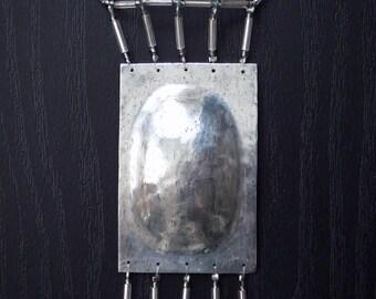 light necklace with zinc pendant