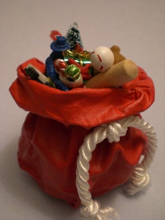 Santa s bag of toys christmas ornament