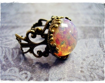Fire Opal Round Glass Cabochon Ring with an Ornate Antique Brass Filigree Band