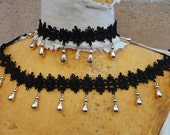 Very nice embroidered black trim  with gold beats hanging 1 yard listing