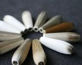Delicate vintage silky teardrop beads. Light shades.