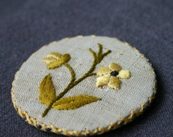 Old precious Spring badge. Antique embroidered pin cushion.
