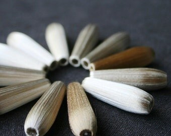 Delicate vintage silky teardrop beads.