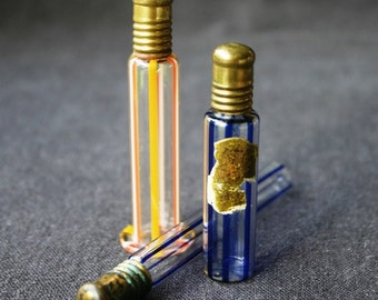 Precious perfume. Series of 3 antique miniature glass vials bottles.