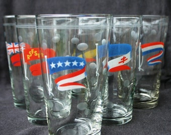 Around the World with 6 vintage collectible glasses. International multicolor flags.