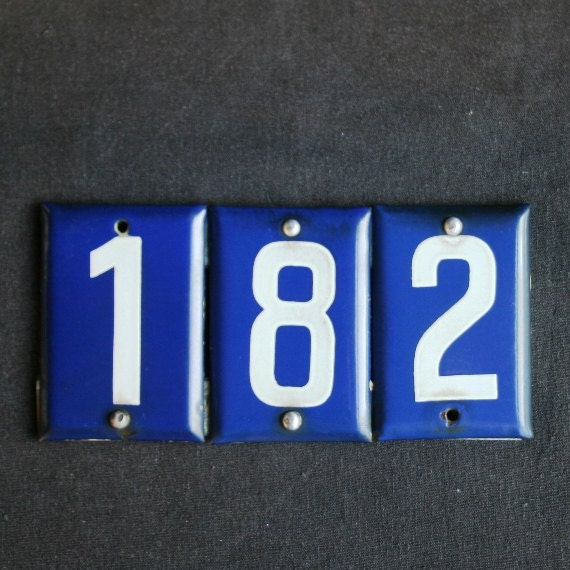 Lucky number 182. Vintage house address enamel plate.