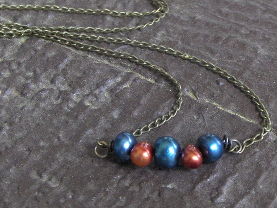 Ocean's Peacock. Teal and Orange Pearl necklace on brass