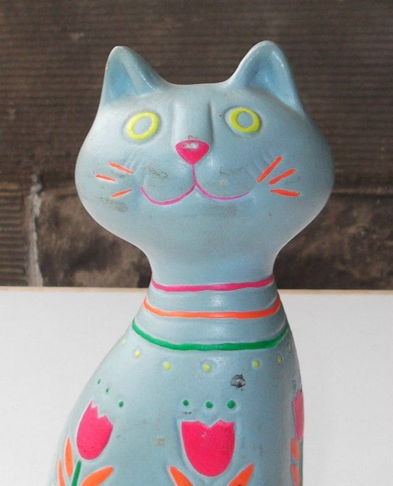 spacey day glow kitty cat coin bank with neon tulips