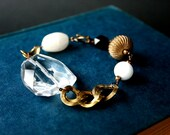 glass stone bracelet. faceted geometric prism, milk white glass and vintage brass. by baltica