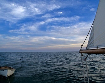 A Classic Dingy Trailing a Wooden Sailboat on Lake Erie Fine Art Photo