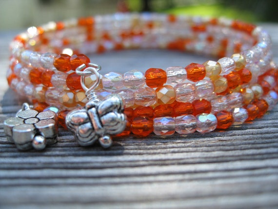 Orange Butterfly slinky bracelet - Czech crystals with flower and butterfly charms