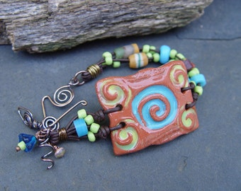 Terra Cotta Stoneware and African Beads on Greek Leather Bracelet