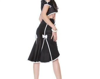 Black fishtail skirt with white seamed detail and bows.