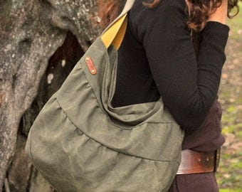 Stonewashed Italian canvas shoulder bag, Kerkira in  light military color with leather details.
