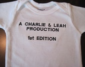 newborn bodysuit embroidered with  1st Edition and mom & dad's names