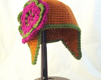Pointed Baby Hat with Earflaps in Pumpkin Spice with Magenta and Olive Green Oversized Flower
