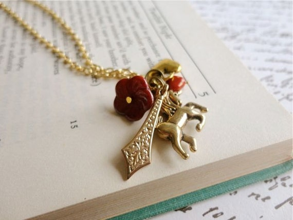 Arthurian Legend camelot and fantasy themed charm necklace, unicorn, red heart, flower, sword, and golden heart charms