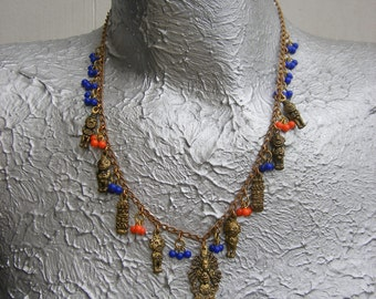 Azteca,  OOAK necklace of Aztec charms w orange and blue glass beads
