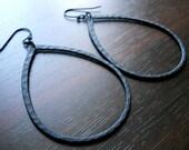 ERRATIC BLACK PEARS- Erratically Hammered Pear Shaped Black Hoop Earrings