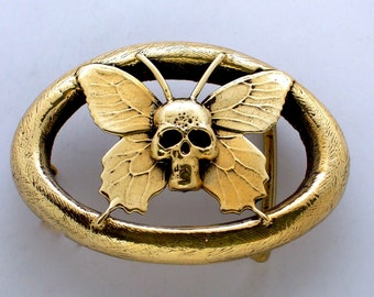 "the ""BENT BUTTERFLY SKULL"" Buckle in Gold Tone Solid Brass"