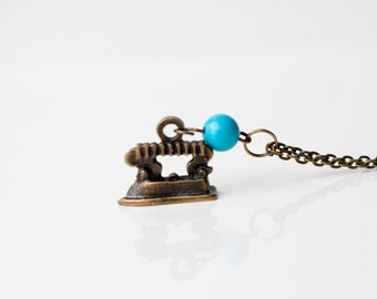 Fun charm necklace vintage style iron with turquoise bead antiqued bronze necklace