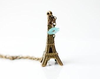 Paris necklace - Big Eiffel tower charm, antiqued bronze and a light blue flower