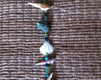 Tan Fingered Shell Hanging Sea Strand, with teal, blues, & greens
