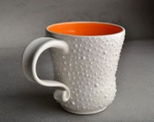 Dottie Mug: MADE TO ORDER One White Coffee Mug Cup With Orange Interior by Symmetrical Pottery