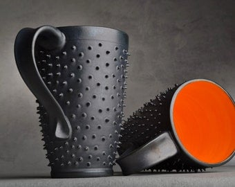 Spiky Mugs Made To Order Four Black and Orange Dangerously Spiky Travel Mugs by Symmetrical Pottery