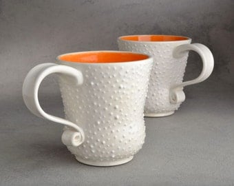 Dottie Mugs Made To Order Two White With Orange Interiors by Symmetrical Pottery