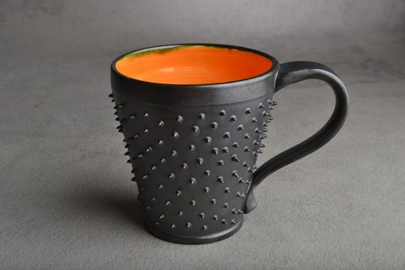 Spiky Coffee Mug: Made To Order Black and Orange Dangerously Spiky Coffee Mug by Symmetrical Pottery