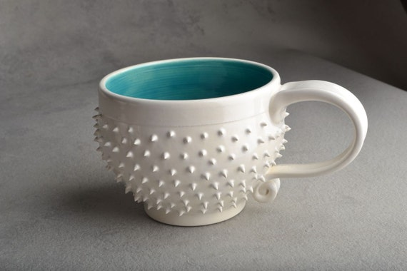 Spiky Mugs: Made To Order Set Of Four White and Caribbean Blue Dangerously Spiky Cocoa/Soup Mugs by Symmetrical Pottery