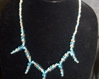 Blue and White Starburst Necklace with a Heart Pendant