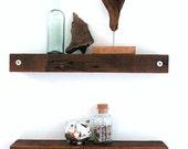 Floating reclaimed wood shelves.