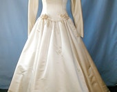 Exquisitely designed wedding dress by Carnela Sutera size 8