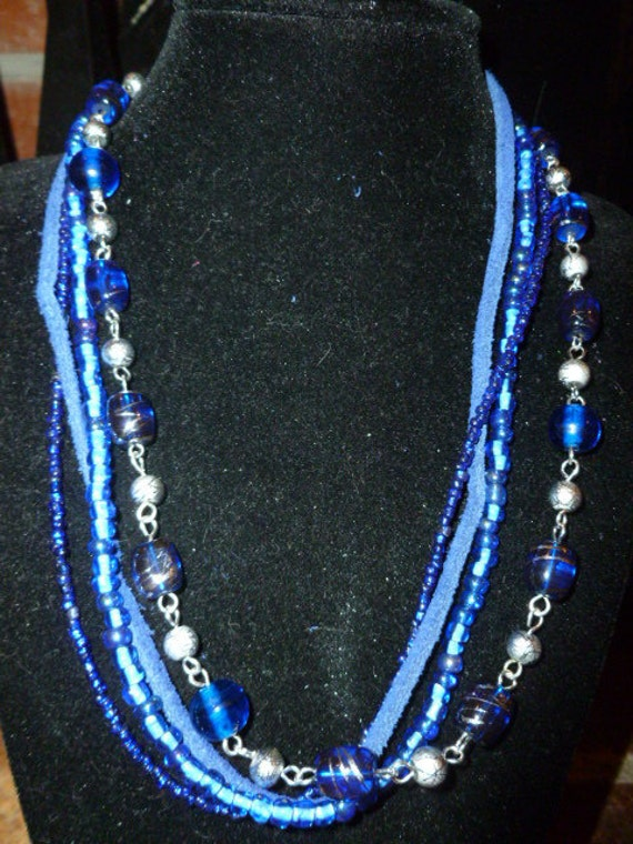 Blue and Silver Leather and Beads four strand necklace with attitude