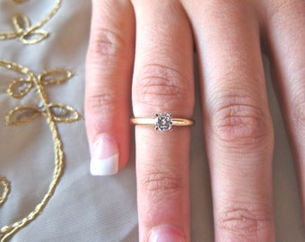 Single round solitare 14k yellow engagement ring
