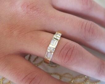 Channel set baguetts & round diamonds on 14K yellow gold wedding band