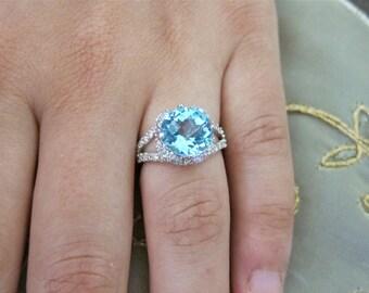 Round Blue Topaz Set on 18K white gold diamond ring.